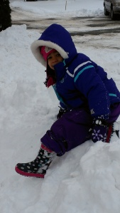 Amara made a slide out of the snow plowed from the parking lot